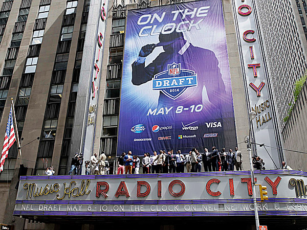 The 2014 NFL draft prospects line up on the awning of Radio City Music Hall. (Seth Wenig/AP)