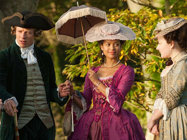 """Belle"" stars Gugu Mbatha-Raw (center) as a black woman raised amid privilege in late-1700s England. It was inspired by a portrait."