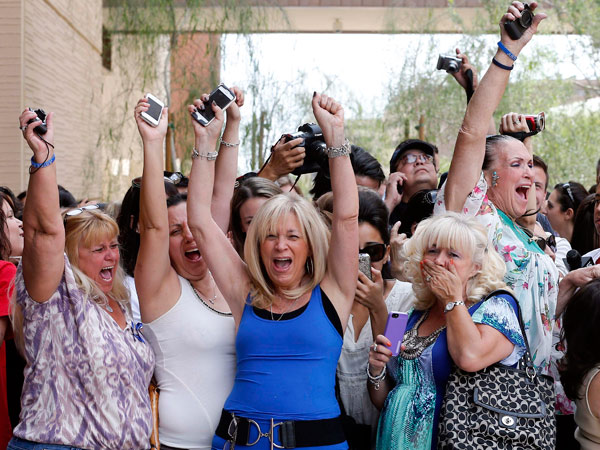 Spectators react to a guilty verdict in the murder trial of Jodi Arias, Wednesday, May 8, 2013 in Phoenix. Arias was convicted of first-degree murder Wednesday in the 2009 killing of her one-time boyfriend Travis Alexander after a four-month trial.  (AP Photo/Matt<br />York)