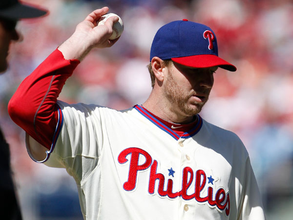 Roy Halladay holds baseball against the Miami Marlins on Sunday, May 5, 2013. (Yong Kim/Staff Photographer)
