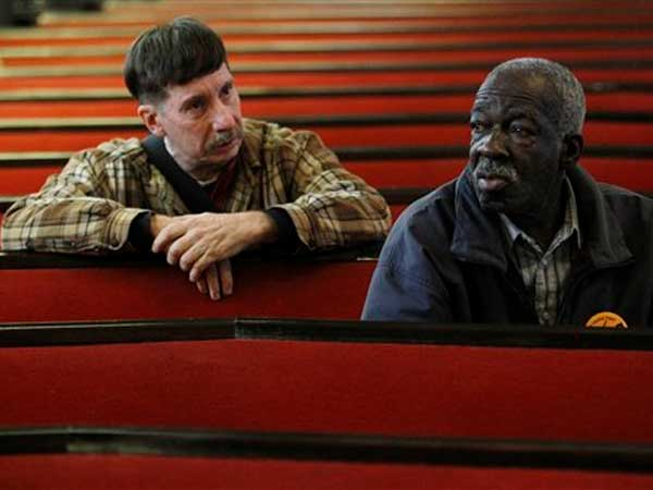 "In this photo taken Nov. 22, 2010, Dale Shillito, left, who has been unemployed since Aug., and Rev. James Pittman attend a ""Vigil for the Unemployed"" at the Arch Street Methodist Church in Philadelphia. (AP Photo / Matt Rourke)"