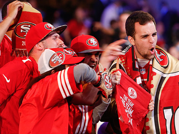 49ers fans cheer during the second round of the 2014 NFL Draft, Friday, May 9, 2014, in New York. (Jason DeCrow/AP)