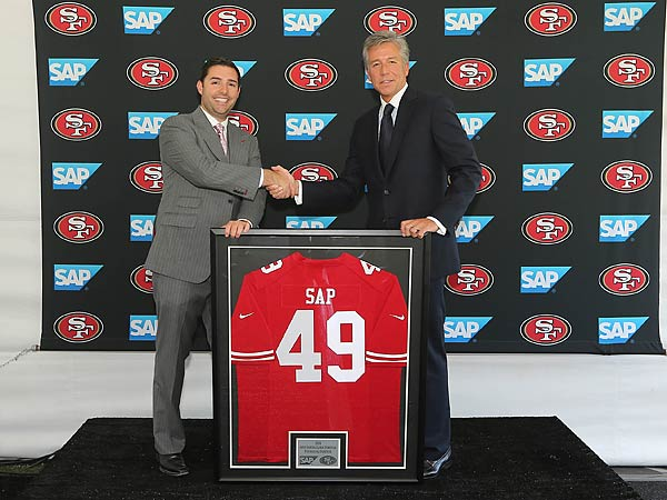 "Bill McDermott, Newtown Square-based co-CEO of global software giant SAP, with San Francisco 49ers CEO Jed York after announcing their software joint venture. ""It's about bringing these mundane data sets to life,"" says NFL digital media vice-president Vishal Shah, a Penn grad."