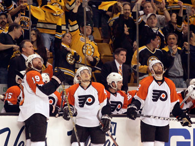 Scott Hartnell, Danny Briere, and Ville Leino stand in front of a crowd of Bruins fans. (Yong Kim / Staff Photographer)