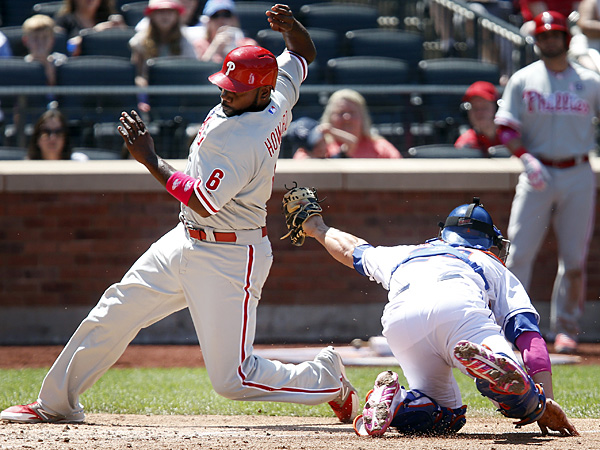 Ryan Howard evades a tag at home by Mets catcher Anthony Recker to score on an RBI single by Domonic Brown during the fourth inning on Sunday, May 11, 2014, in New York. (Jason DeCrow/AP)