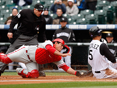Carlos Ruiz left the game in the fourth inning and was replaced by Paul Hoover. (AP Photo/Ed Andrieski)