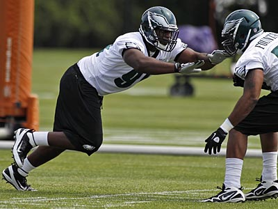 Defensive tackle Fletcher Cox works against Maurice Fountain during the first day of rookie minicamp. (Alex Brandon/AP)