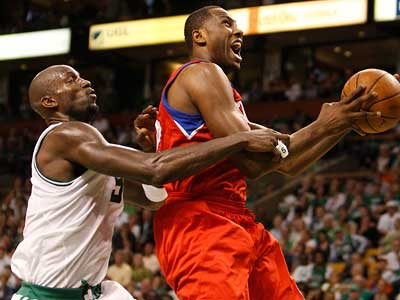 Elton Brand is fouled by the Celtics´ Kevin Garnett in Game 1 of their semifinal playoff series in Boston. (Ron Cortes/Staff Photographer)