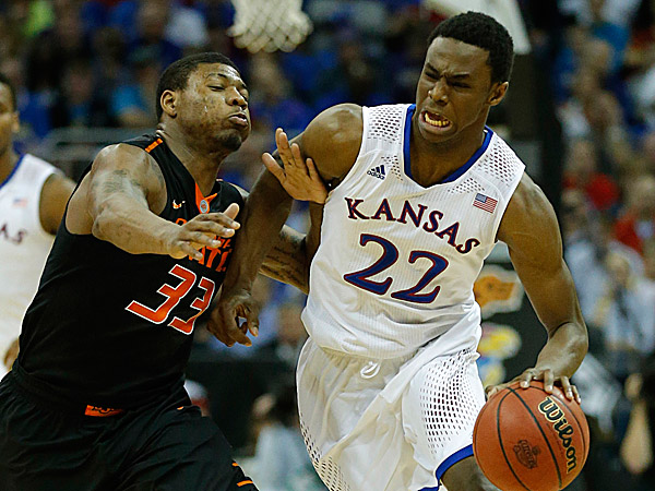 Kansas guard Andrew Wiggins is covered by Oklahoma State guard Marcus Smart. (Orlin Wagner/AP)