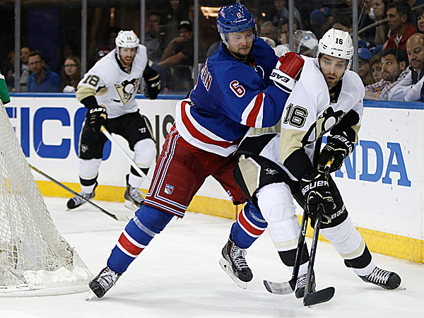 Rangers defenseman Anton Stralman defends Penguins center Brandon Sutter. (Kathy Willens/AP)