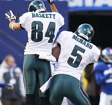 Hank Baskett (84) and Donovan McNabb (5) celebrate a play during the 2008 season. (AP / File photo)