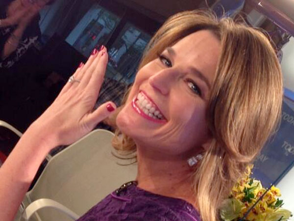 "Guthrie flashes her engagement ring for the ""Today"" show team. (Photo: Matt Lauer / Twitter)"