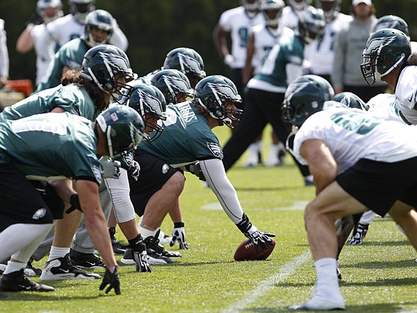Dallas Reynolds, center, prepares to hike the ball as the Eagles held<br />organized team activities at the NovaCare Complex in Philadelphia on<br />May 13, 2013. (David Maialetti/Staff Photographer)