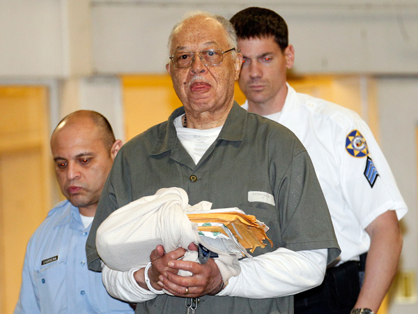 Dr. Kermit Gosnell gets escorted to a van leaving the Criminal Justice Center after being convicted on three counts of first degree murder. (Yong Kim / Staff Photographer, file)