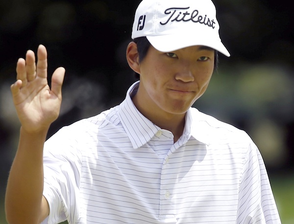Michael Kim reacts after putting on the first hole during the third round of the U.S. Open golf tournament at Merion Golf Club, Saturday, June 15, 2013, in Ardmore, Pa. (AP Photo/Morry Gash)