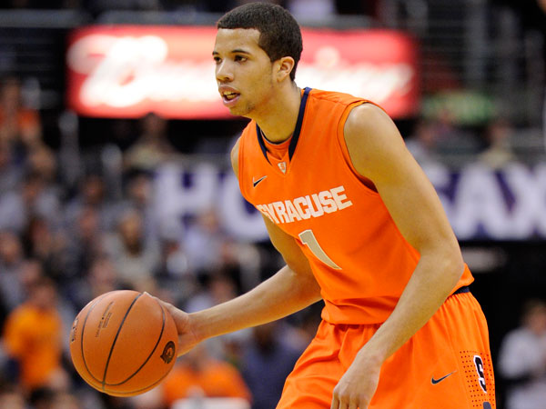 Syracuse guard Michael Carter-Williams (1) dribbles the ball against Georgetown during the first half of an NCAA college basketball game, Saturday, March 9, 2013, in Washington. (Nick Wass/AP file)