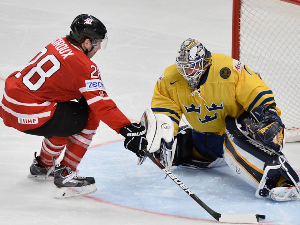 Claude Giroux (left) tries to score against Sweden´s goalie Jhonas Enroth in the penalty shootout during the 2013 Ice Hockey IIHF World Championships quarterfinal between Canada and Sweden in Stockholm, Thursday, May 16, 2013. (Anders Wiklund/AP, Scanpix Sweden)