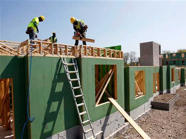 In this Wednesday, April 24, 2013, photo, workers are seen at the construction of a new apartment housing complex in Trenton, N.J. The Commerce Department reports the pace at which builders broke ground on homes in April on Thursday, May 16, 2013. (AP Photo/Mel Evans)