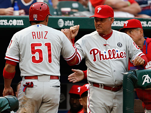 Carlos Ruiz (51) is congratulated by manager Ryne Sandberg after scoring a run against the Texas Rangers during the first inning of a baseball game on Wednesday, April 2, 2014, in Arlington, Texas. (Jim Cowsert/AP)