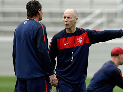 U.S. coach Bob Bradley (center) oversaw the first day of practice at Princeton University´s soccer stadium. (Mel Evans/AP)
