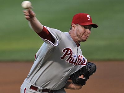 Roy Halladay allowed four runs in two innings before leaving with shoulder soreness on Sunday. (Brian Kersey/AP)