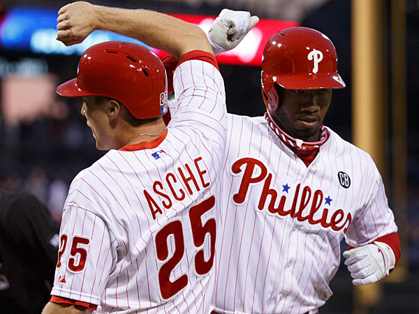 Domonic Brown, right, celebrates his two-run homer with Cody Asche during the fourth inning of a baseball game against the Cincinnati Reds, Saturday, May 17, 2014, in Philadelphia. (Chris Szagola/AP)