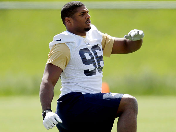 St. Louis Rams rookie defensive end Michael Sam stretches during the team´s NFL football rookie camp Friday, May 16, 2014, in St. Louis. (Jeff Roberson/AP)