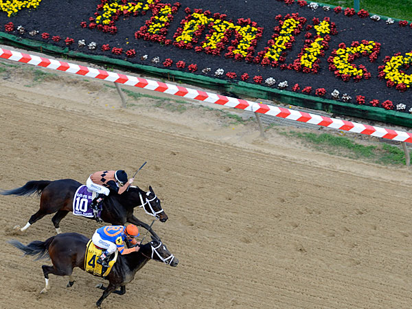 Stopchargingmaria (4), ridden by Javier Castellano, holds off Vero Amore with Frank Pennington aboard, to win the Black-Eyed Susan Stakes horse race Pimlico Race Course, Friday, May 16, 2014, in Baltimore. The 139th Preakness horse race takes place Saturday. (Gary Jones/AP)