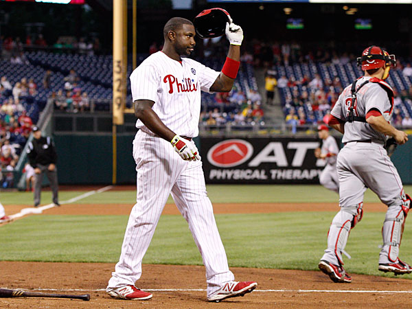 Ryan Howard takes his helmet off after striking out to the third inning of a baseball game against the Cincinnati Reds, Friday, May 16, 2014, in Philadelphia. The Reds won 3-0. (Chris Szagola/AP)