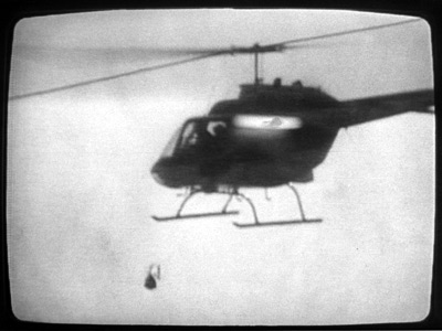 A police helicopter drops the bomb on the MOVE compound on May 13, 1985, as captured by a Channel 10-WCAU camera.