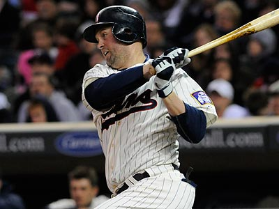 The Twins´ Michael Cuddyer could fill the Phillies´ need for a right-handed bat. (Jim Mone/AP)
