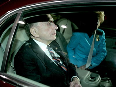 Arlen Specter and his wife Joan leave his campaign´s election night headquarters after conceding to Joe Sestak.  (Charles Fox / Staff Photographer)