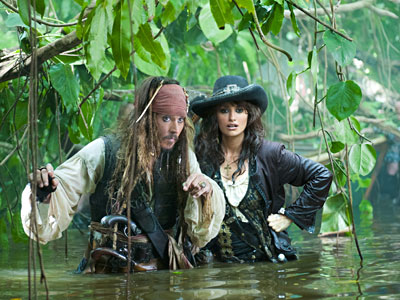 "Johnny Depp and Penelope Cruz make their watery way through the jungle in search of the Fountain of Youth in ""Pirates of the Caribbean: On Stranger Tides."" (Photo / Peter Mountain)"