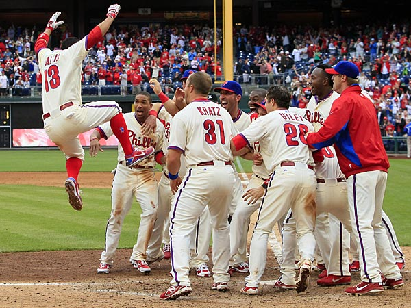 Philadelphia Phillies&acute; Freddy Galvis leaps into the group of his<br />teammates after hitting a game-winning solo-home run in the ninth<br />inning of the MLB National League baseball game with the Cincinnati<br />Reds, Sunday, May 19, 2013, in Philadelphia.  The Phillies won 3-2.<br />(AP Photo/Tom Mihalek)