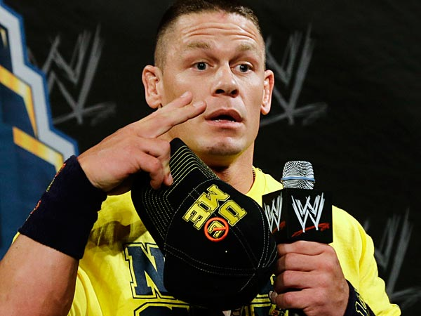John Cena speaks Chinese for Chinese reporters during a news conference before the WWE Wrestlemania 29 wrestling event, Sunday, April 7, 2013, in East Rutherford, N.J.(AP Photo/Mel Evans)
