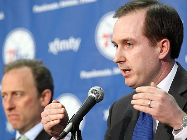 New General Manager Sam Hinkie (right) answers questions with Sixers Managing Owner Josh Harris in the background at Philadelphia College of Osteopathic Medicine gym on Tuesday, May 14, 2013.  (Yong Kim/Staff Photographer)