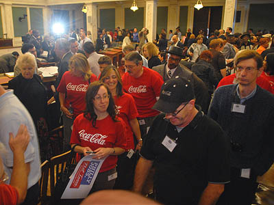 Coca-Cola workers and others leave after council voted against Mayor Michael Nutter´s controversial soda tax, effectively killing the bill. In response, Nutter announced the need to cut $20 million from the budget and eliminate 339 positions. (Tom Gralish / Staff Photographer)