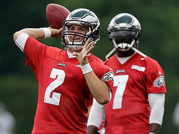The Eagles have a good, old fashioned quarterback competition that will play out through the hot days of training camp. (Matt Rourke/AP)