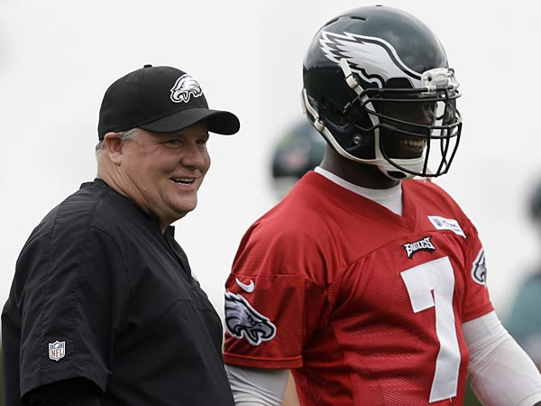Philadelphia Eagles head coach Chip Kelly and quarterback Michael Vick (7) smile during practice at the team´s NFL football training facility, Monday, May 20, 2013, in Philadelphia. (AP Photo/Matt Rourke)