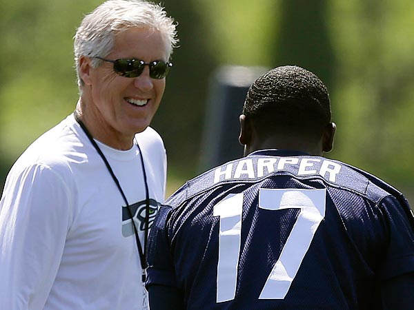 Seattle Seahawks head coach Pete Carroll, left, talks to Chris Harper during drills at NFL football rookie minicamp, Friday, May 10, 2013, in Renton, Wash. (AP Photo/Ted S. Warren)