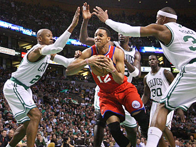 Sixers guard Evan Turner gets swarmed by Celtics as he tries to drive the lane. (Ron Cortes/Staff Photographer)