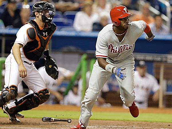 The Phillies´ Domonic Brown grounds out to first to score Ryan Howard in the sixth inning. (Lynne Sladky/AP)