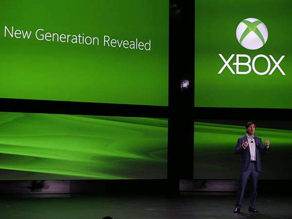 Microsoft Corp.´s Don Mattrick unveils the next-generation Xbox entertainment and gaming console system, Tuesday, May 21, 2013, at an event in Redmond, Wash. It´s been eight years since the launch of the Xbox 360. The original Xbox debuted in 2001, and its high-definition successor premiered in 2005. (AP Photo/Ted S. Warren)