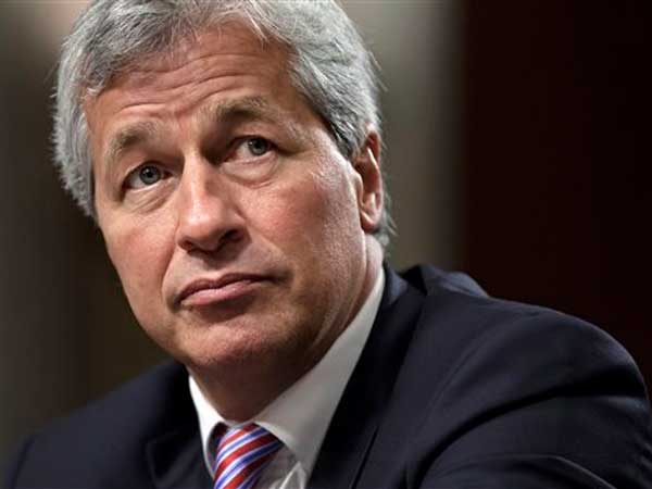 FILE - In this Wednesday, June 13, 2012, file photo, JPMorgan Chase CEO Jamie Dimon, head of the largest bank in the United States, testifies before the Senate Banking Committee on Capitol Hill in Washington. (J. Scott Applewhite / Associated Press)