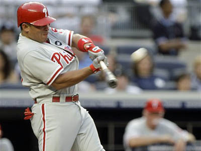 Carlos Ruiz follows through on a two-run homer during the second inning against the New York Yankees on Friday. The Phils snapped the Yanks winning streak. (AP)