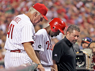 Jimmy Rollins was placed back on the 15-day disabled list after injuring his calf in Friday´s game. (Steven M. Falk / Staff Photographer)