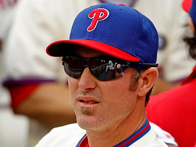 Chase Utley watched Sunday´s game from the Phillies dugout after rejoining the team. (Ron Cortes/Staff Photographer)