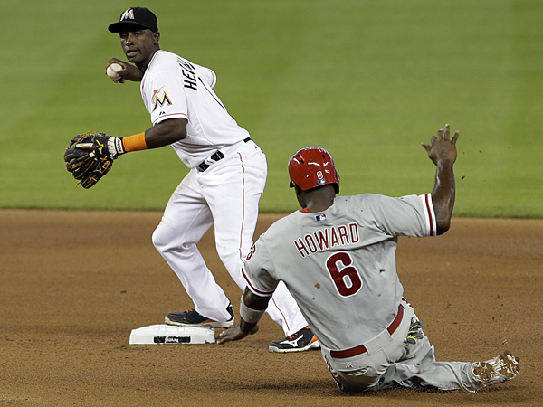 Phillies first baseman Ryan Howard is forced out at second base as Marlins shortstop Adeiny Hechavarria prepares to throw to first on Thursday, May 22, 2014. (Alan Diaz/AP)