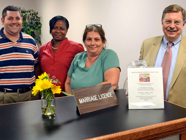 Under court order: Register of Wills Bruce Hanes (far right), clerks Drew Albert and Lisa Wayne (center), deputy registrar Helene Sepulveda (right) in ´13. (Tom Gralish / Staff Photographer)