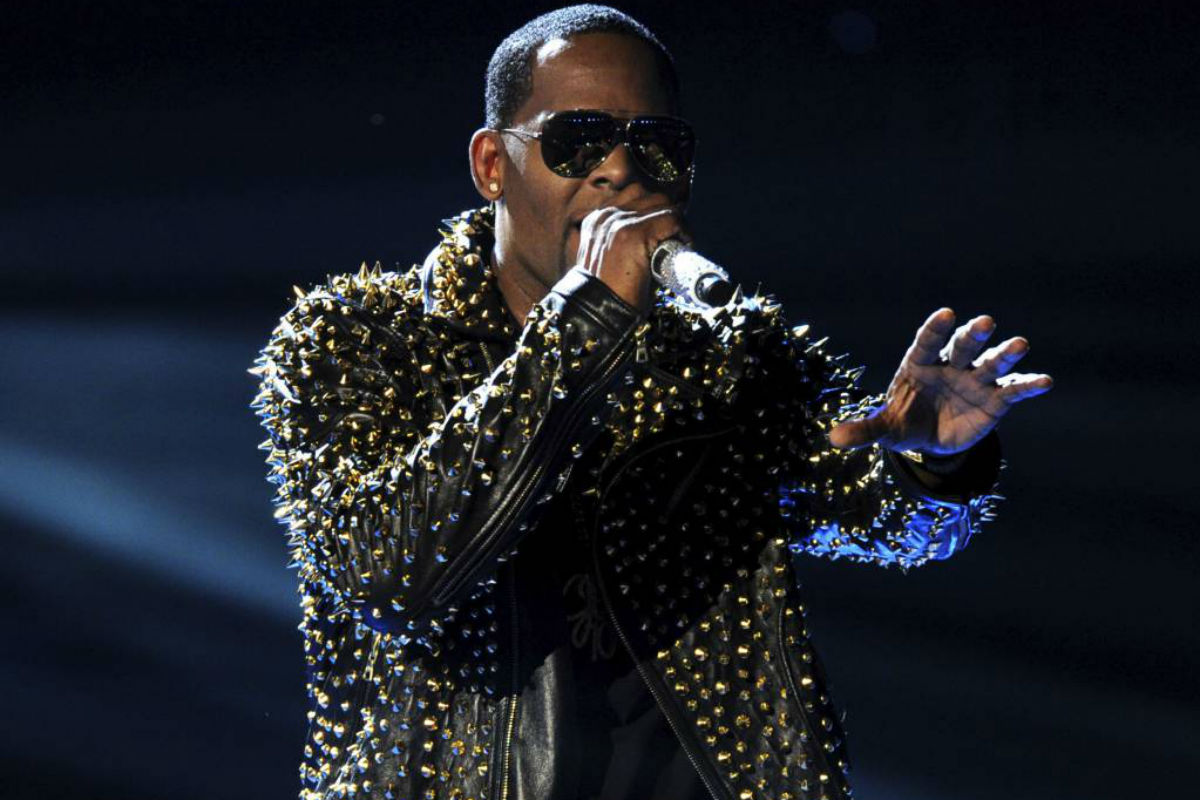 FILE - In this June 30, 2013, file photo, R. Kelly performs onstage at the BET Awards at the Nokia Theatre in Los Angeles. A woman filed a lawsuit Monday, May 21, 2018, in New York against R. Kelly, claiming the singer sexually assaulted her. He has long been the target of sexual misconduct allegations, which he has denied.
